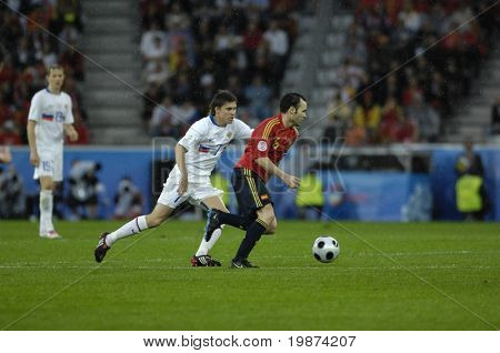 INNSBRUCK - JUNE 10: Andr�©s Iniesta of Spain (in red) & Dmitri Torbinskiy of Russia (in white)  during the match Spain-Russia 4:1 Euro2008 Group D. June 10, 2008, in Innsbruck, Austria