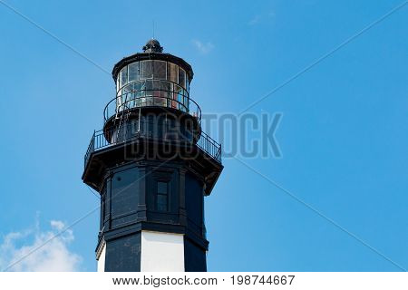 VIRGINIA BEACH, VIRGINIA - JULY 11, 2017:  Close-up view of the top of the New Cape Henry Lighthouse, built in 1881, it is located on the Fort Story military base.