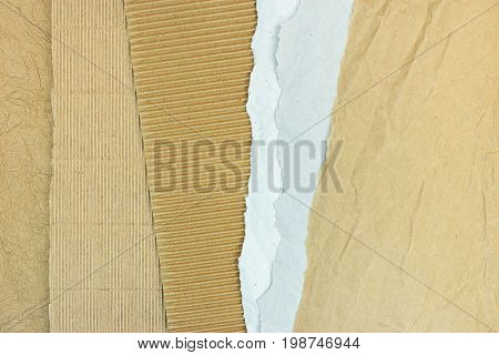 Brown Corrugated Cardboard With Grey Torn Paper Sheets