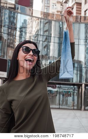 Shot of a happy young woman on a shopping spree in the city