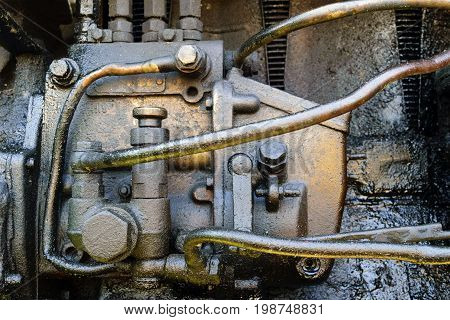 Old dirty diesel tractor engine with soot and oil