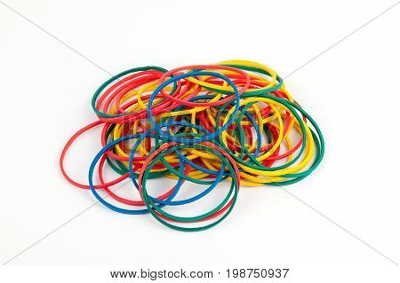Colorful rubber bands on white background. Stationery