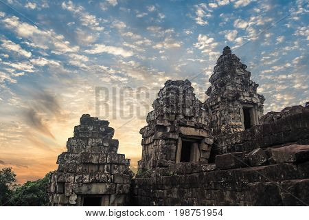 Sunrise at Angkor Wat,Buddhism monk walking to Angkor wat most popular among tourists ancient landmark and place of worship in Southeast Asia. Siem Reap, Cambodia.
