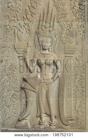 Angkor Wat Siem Reap Cambodia.Carved Art Sand stone sculpture on the wall at Angkor Wat. Apsara is an angle of ancient Cambodia in Hindu religion.