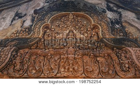 Khmer architecture carved red stone in Banteay Srei temple .Banteay Srei is one of the most popular ancient temples in Siem Reap Banteay Srei known for its beautiful carvings on red sandstone Cambodia