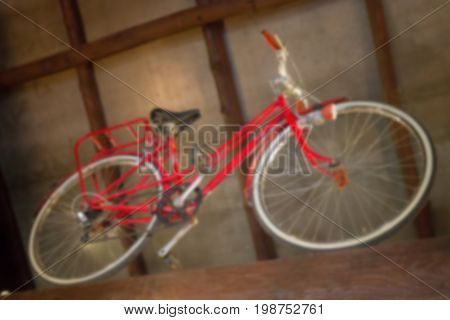 Red retro bicycle showed on the ceiling stock photo