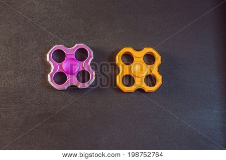 Famous Fidget Spinner Stress Relieving N A Black Wooden Background