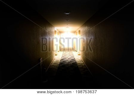 light shining from the end of dark corridor