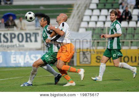 KAPOSVAR, HUNGARY - AUGUST 29: Krisztian Pest (L) and Denes Rosa (C) in action at Hungarian National Championship soccer game Kaposvar vs Ferencvaros August 19, 2009 in Kaposvar, Hungary.