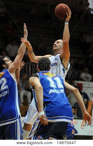 KAPOSVAR, HUNGARY - SEPTEMBER 4: Gergely David (in white) in action at a friendly basketball game Kaposvar vs Albacomp September 4, 2009 in Kaposvar, Hungary.