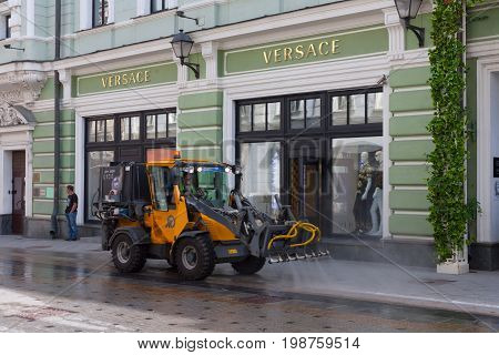 MOSCOW - AUGUST 7: Watering machine in Stoleshnikov Lane on August 7 2017 in Moscow. Stoleshnikov lane is pedestrian street in the center of Moscow.