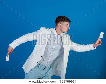 Businessman Posing In White Jacket, Shirt And Pants