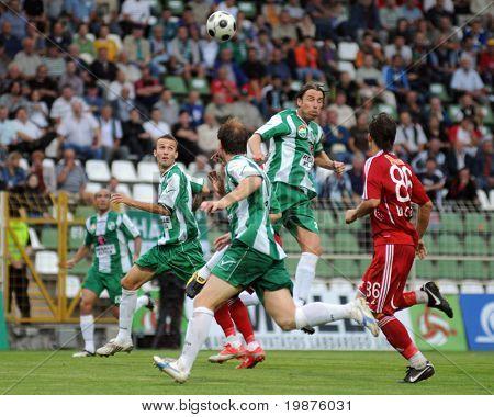 KAPOSVAR, HUNGARY - SEPTEMBER 25: Krisztian Zahorecz (2nd from R) heads a ball at a Hungarian National Championship soccer game Kaposvar vs Debrecen September 25, 2009 in Kaposvar, Hungary.