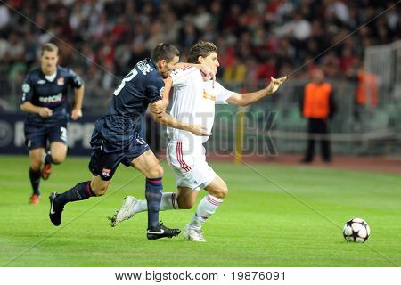 BUDAPEST - SEPTEMBER 29: Unidentified players in action at the UEFA Champions League football game Debrecen vs Lyon, UEFA Champions League football game, September 29, 2009 in Budapest, Hungary.