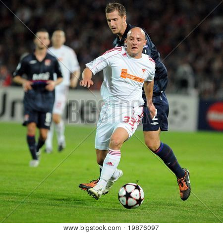 BUDAPEST - SEPTEMBER 29: Zoltan Varga (33) in action at the UEFA Champions League football game Debrecen vs Lyon, UEFA Champions League football game, September 29, 2009 in Budapest, Hungary.