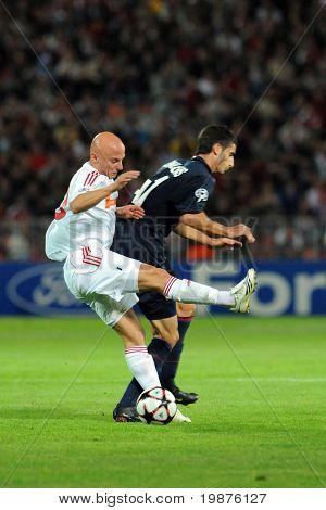 BUDAPEST - SEPTEMBER 29: Varga (L) and Gonalons in action at the UEFA Champions League football game Debrecen vs Lyon, September 29, 2009 in Budapest, Hungary.