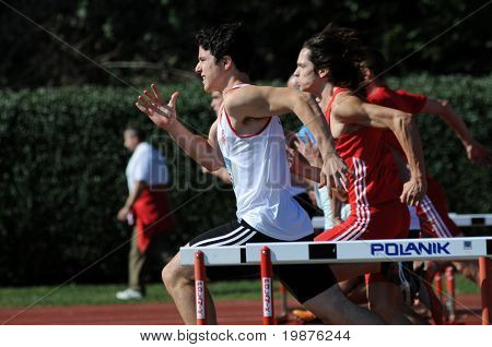 KAPOSVAR, HUNGARY - OCTOBER 3: Unidentified competitors in action at the athletics competition of under 16 national teams of Hungary, Croatia and Slovenia, October 3, 2009 Kaposvar, Hungary