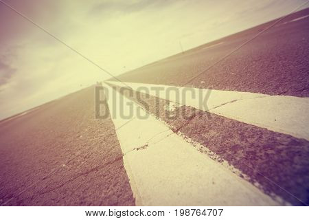 Asphalt road with marking lines white stripes. Two solid lines.