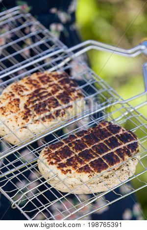 Top view on two grilled slices of homemade halloumi cheese on grill. Outdoors.Grilling season.