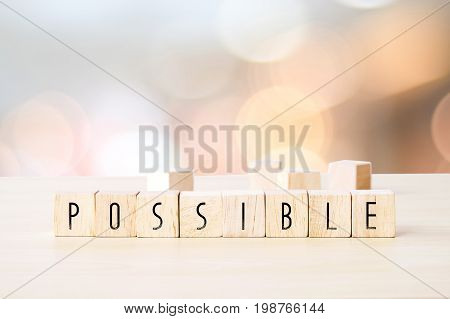 Possible word on wooden cubes background business concept positive thinking