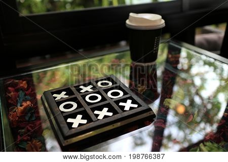 OX game in wood case on a Coffee Shop Table