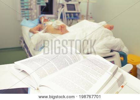 Reading book in the hospital ward. Medical study