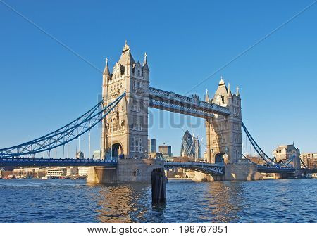 Tower Bridge as viewed from the bank of the river Thames