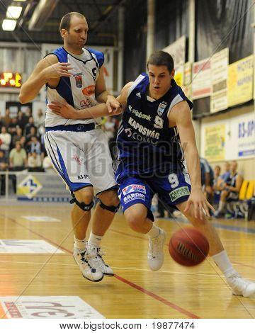 DOMBOVAR, HUNGARY - NOVEMBER 7: Deak (L) and Vojvoda (R) in action at Hungarian National Championship basketball game, Dombovar vs Kaposvar, on November 7, 2009 in Dombovar, Hungary.