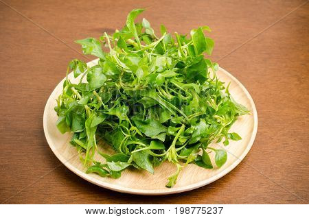Fresh watercress on wooden plate,organic vegetables for cooking