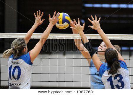 KAPOSVAR, HUNGARY - OCTOBER 25: Petras (10) and Toth (13) blocks the ball at the Hungarian NB I. League woman volleyball game Kaposvar vs Eger, October 25, 2009 in Kaposvar, Hungary.
