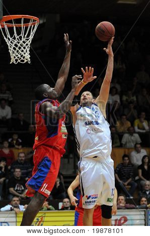 KAPOSVAR, HUNGARY - DECEMBER 5: Laszlo Orosz (in white) in action at Hungarian National Championship basketball game with Kaposvar vs Nyiregyhaza on December 5, 2009 in Kaposvar, Hungary.