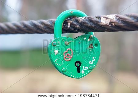 Village Ivanovskoe, Russia - May 9, 2017: Green Wedding closed lock in the form of heart.