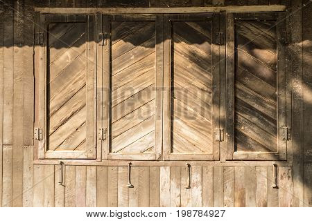 Wooden Wall Of House And Window With Roof In Sunny Day,tropical Climate