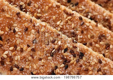 Sesame cakes with cocoa and sugar background