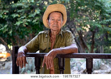 LA MULA SANTIAGO DE CUBA CUBA - NOVEMBER 26: Portrait of the of the sad Cuban farmer on deaths of Fidel Castro photographed in the heart of the Cuban revolution Sierra Maestra mountains on Cuba La Mula in November 26 2016