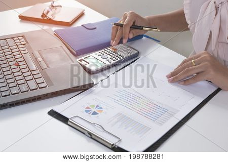 Business person analyzing financial statistics graph on the paperwork