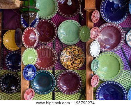 Traditional arabic handcrafted colorful decorated plates on Moroccan souk.