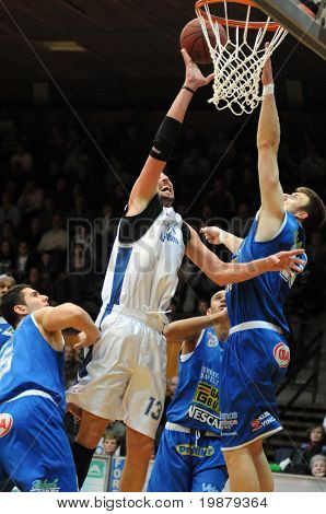 KAPOSVAR, HUNGARY - FEBRUARY 12: Unidentified players in action at a Hugarian Champonship basketball game Kaposvar vs Albacomp February 12, 2009 in Kaposvar, Hungary.