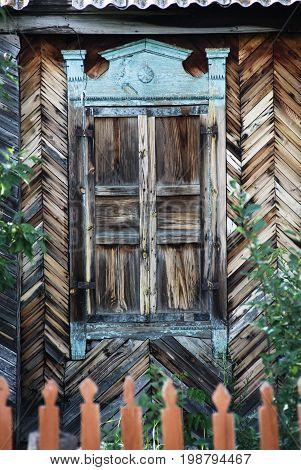 Old wooden window. Russian weekend in a village.
