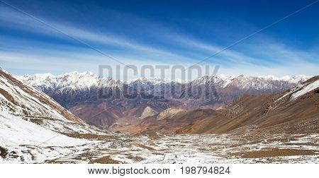 round Annapurna circuit trekking trail view from Thorung La pass to Lower Mustang and Dhaulagiri Himal Nepal