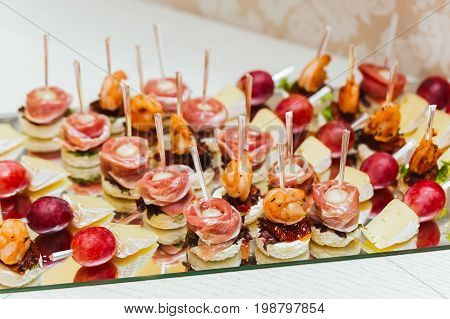 Catering Services. Glass Tray With Snacks With Brie, Grape, Bacon, And Shrimps In A Restaurant. Snac