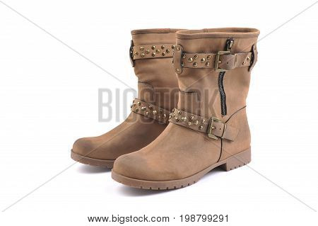 Pair of brown leather women boots isolated on white background