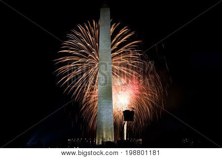 The Washington monument and a police stand are in the foreground of a fireworks display on the 4th of July