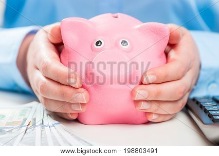 Piggy Bank In The Hands Of Its Thrifty Hostess - Conceptual Photography