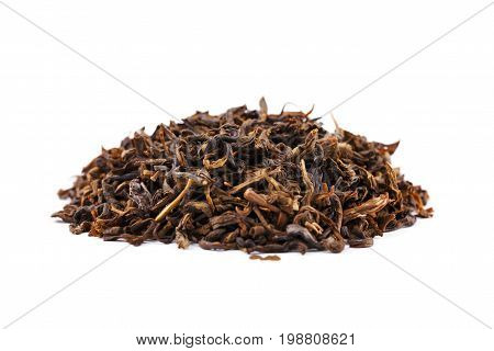 A close-up of a heap of black tea leaves isolated on a white background. A heap of green tea leaves. Winter organic beverage. Healthy tea. Chinese drink. Organic herbals.