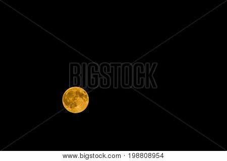 Moon eclipsed by the Earth giving a brown color to it due to the Earth reflection