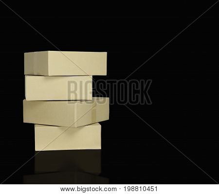 brown paper boxes stacked on blackbackground can used to move in concept and delivery goods concept as recycle and save the world because of reused and protect polution