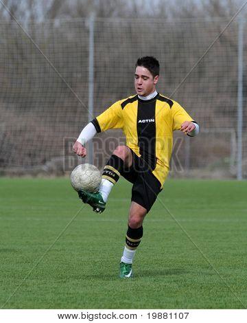 KAPOSVAR, HUNGARY - MARCH 21: Bence Balogh in action at the Hungarian National Championship under 19 game between Kaposvari Rakoczi FC and Pecsi MFC March 21, 2010 in Kaposvar, Hungary.