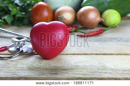 Healthy hearth concept vetgetable and fruit with herb leaf and ear doctor on wood background