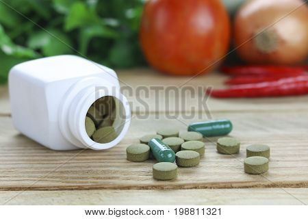 Healthy hearth concept Herbal Medicines with herb leaf and vetgetable on wood background